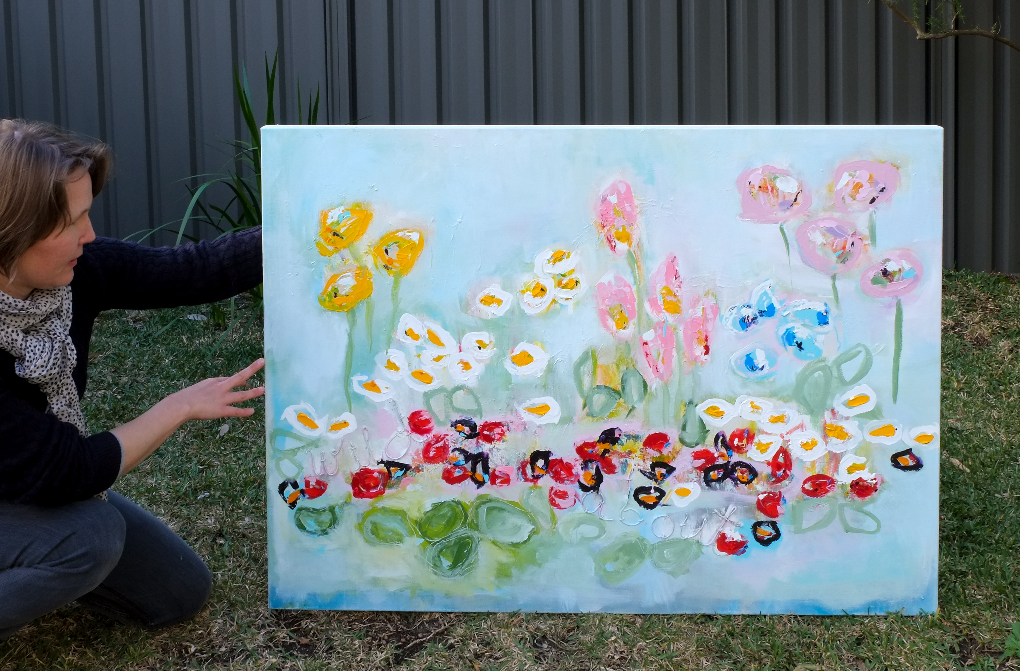 Artist Hela Donela and her painting Wild About Flowers